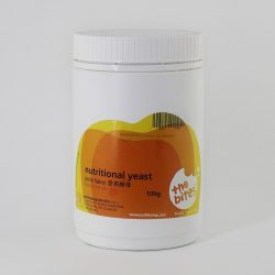 Container of The Bites Nutritional Yeast Mini Flakes